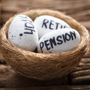 Eggs with the words pension, retire and 401k written on them